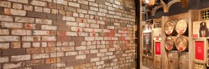 See the actual brick wall from the Chicago storefront where the men who were murdered during the St. Valentine's Day Massacre were propped up. After that day, Al Capone became the undisputed ruler of the Chicago underworld.