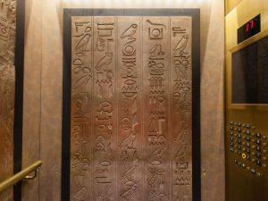 The elevator is at the Luxor Hotel in Las Vegas. The ancient Egyptian themed hotel, and elevator is complete with hieroglyphics and the elevator is tilted at a 39 degree angle so that riders have a rather unusual arial view of the lobby.
