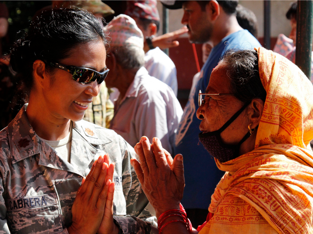 People don't shake hands in Nepal or India. You simply put your hands together in greeting. Bowing is not necessary like in certain Asian countries. In Malaysia, avoid using your fist for anything and don't pound a fist into your open hand. There, it is the same as if you were flipping someone the middle finger in the United States.